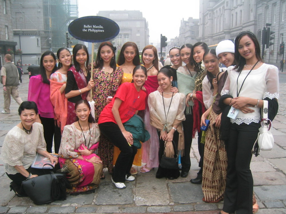 Mrs. Macuja (crouching, leftmost) acts as chaperone as Ballet Manila participates in a dance festival in Aberdeen, Scotland in 2004.
