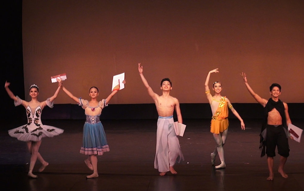 After winning the third prize in the Junior Category of the CCP Ballet Competition in 2014, Rissa May (second from left) celebrated by eating fried chicken.