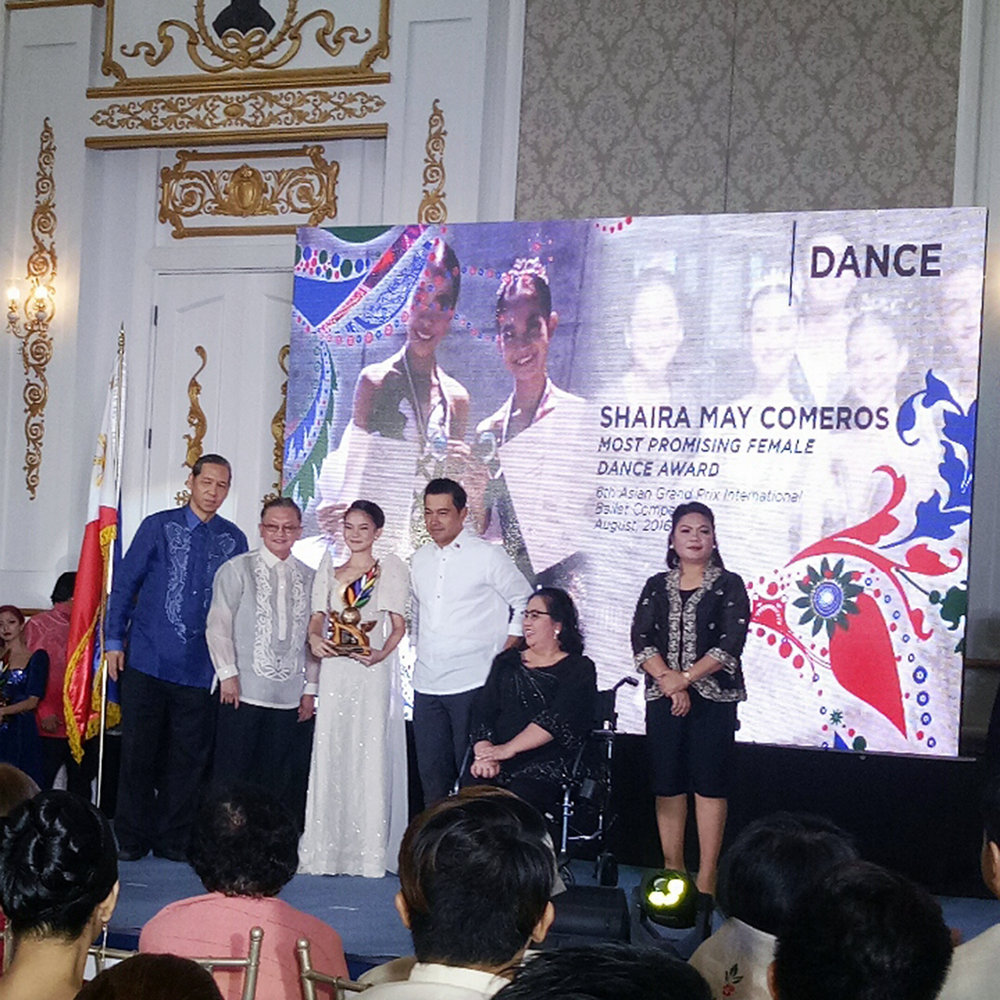 Shaira Comeros receives her Ani ng Dangal award at a program hosted by the National Commission for Culture and the Arts in Intramuros.