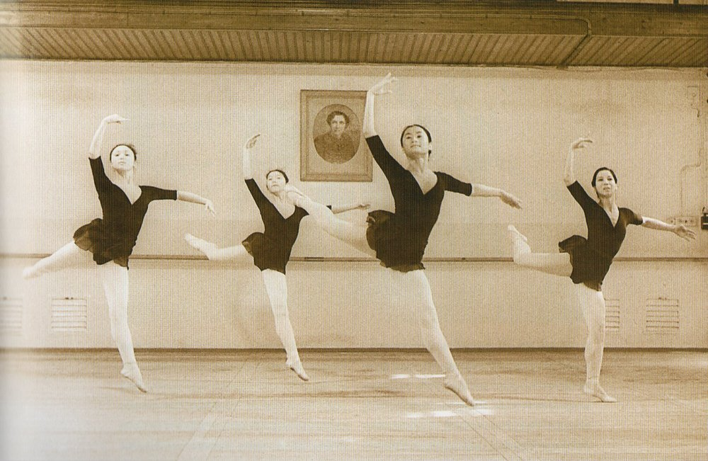A portrait of Agrippina Vaganova hangs in the studio at the Leningrad Choreographic Institute where Lisa Macuja (third from left) learned the training method developed by the ballet pedagogue. Photo courtesy of the Ballet Manila Archives