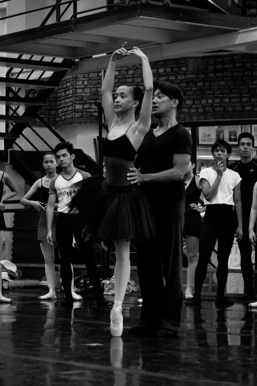 Osias Barroso at work in the studio with Ballet Manila company artist Jessa Balote