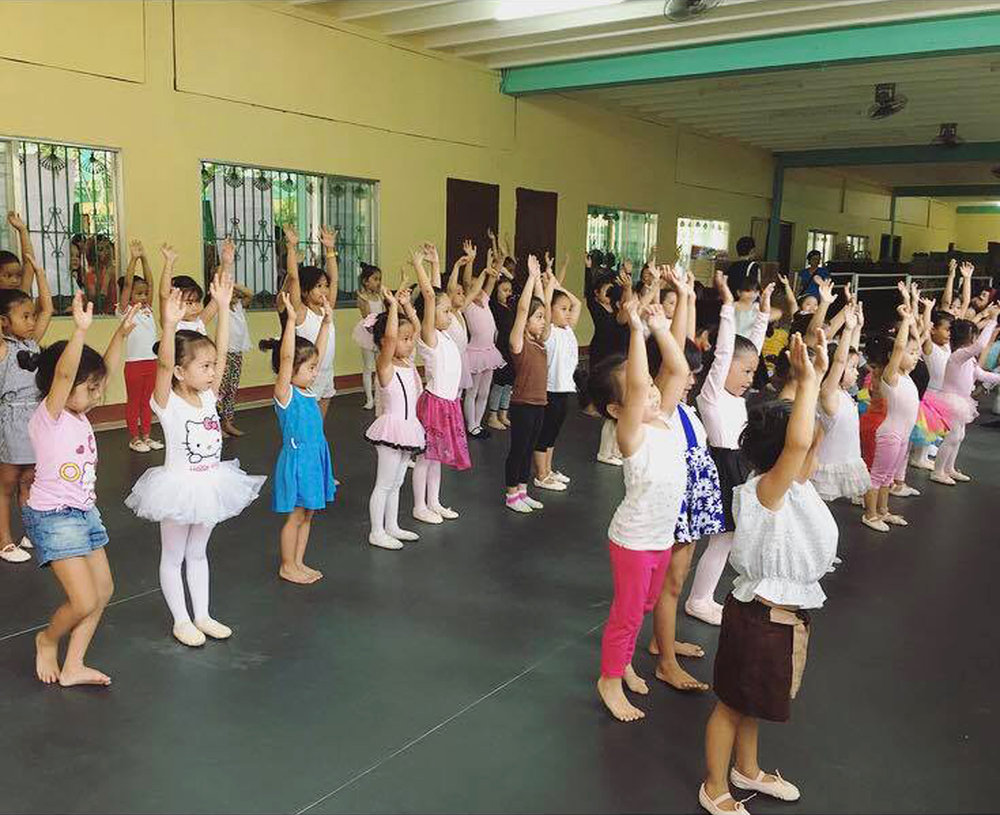 Young girls learn ballet basics as part of the summer art workshop organized by the Lola Grande Foundation for Women and Children at the Sta. Ana Elementary School, with dance classes conducted by Ballet Manila teachers. Photo courtesy of Faith Calingo