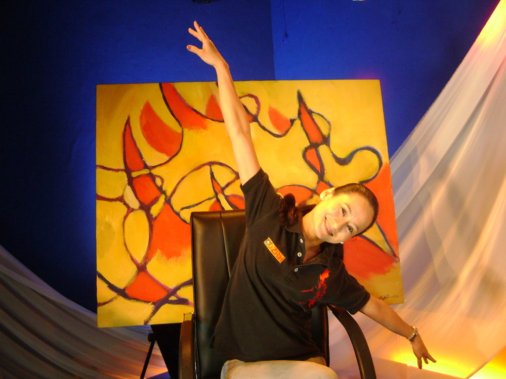 Lisa, shown here on the set of her Art 2 Art program, mimics the dancer's pose depicted in Fred's painting.