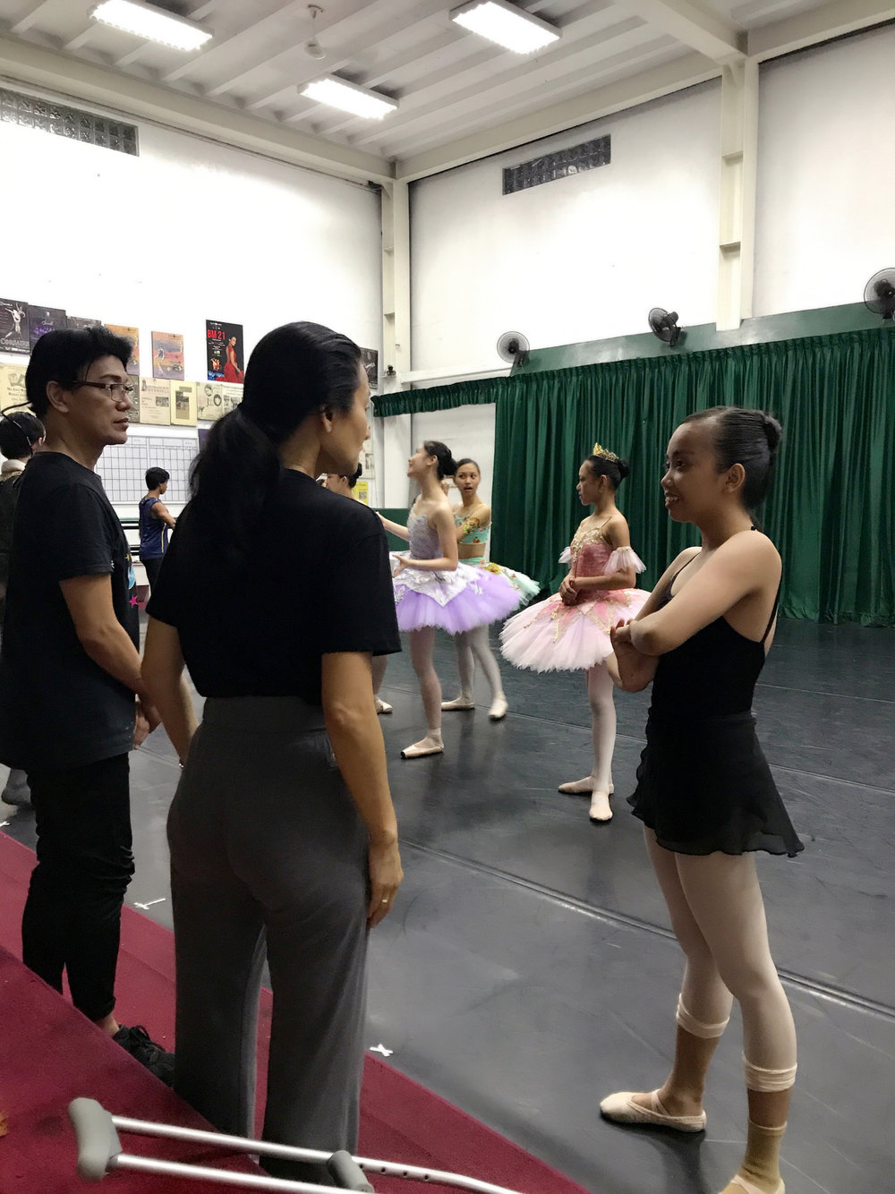 Co-artistic directors Lisa Macuja-Elizalde and Osias Barroso confer with BM trainee Elyssabeth Apilado after rehearsals.