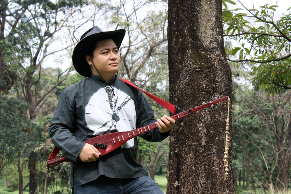 Diwa de Leon has used the many inspirations in his musical life in composing the theme for    Gerardo Francisco's Ibong Adarna   . Here, he holds the hegalong, a two-stringed lute that he likes making music with.