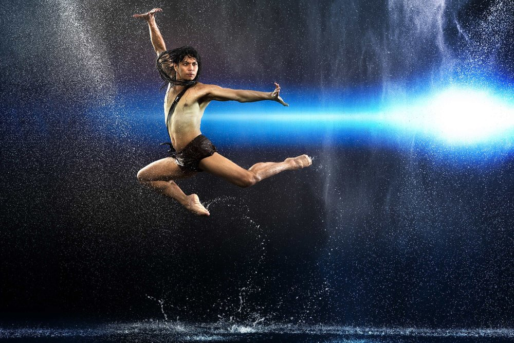 BM soloist Mark Sumaylo leaps through a rainstorm.