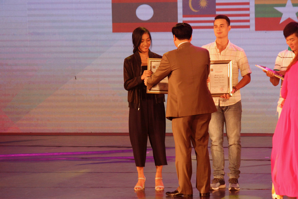Nicole Barroso is given her award as Best Dance Artist, along with fellow awardees Nguyen Van Nam of Vietnam and Lu Peng of China. Photo by Jimmy Villanueva