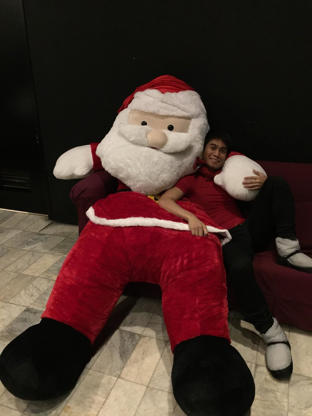 John De Dios spends time with Santa at the backstage of Aliw Theater.