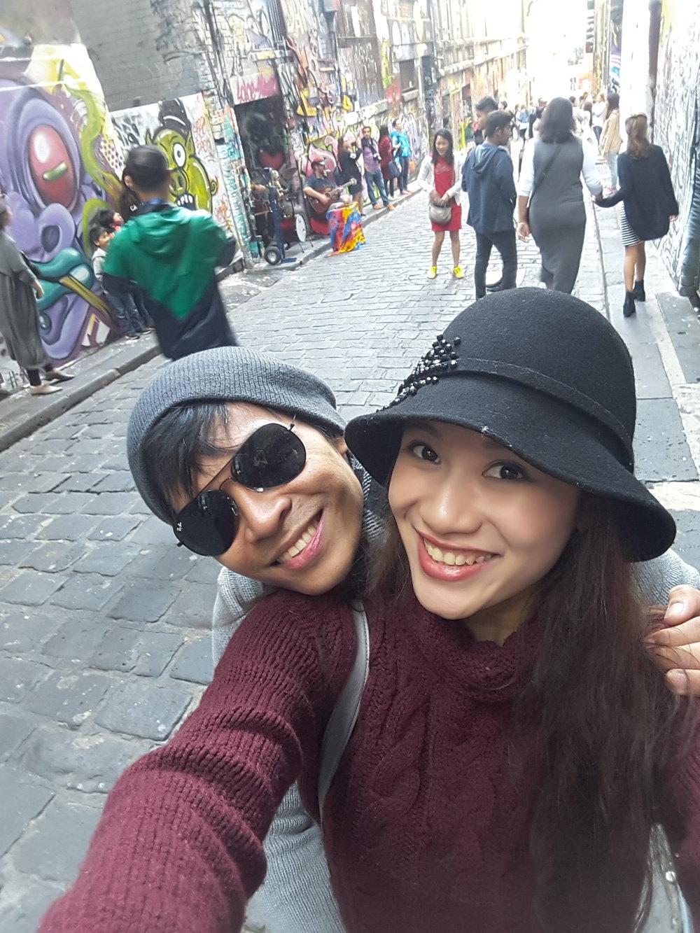 Abigail Oliveiro takes boyfriend Mark Sumaylo on a tour of Melbourne CBD's mural-filled laneways.