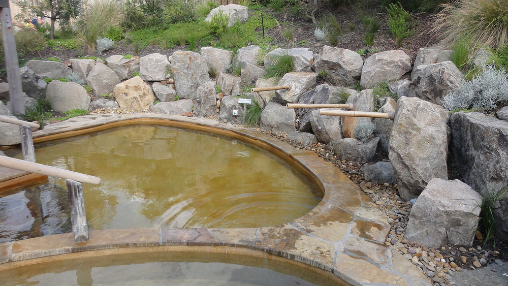 Natural hot mineral waters flow from the ground into pools and private bathing areas at the Peninsula Hot Springs. Photo by  ThinkGeoEnergy