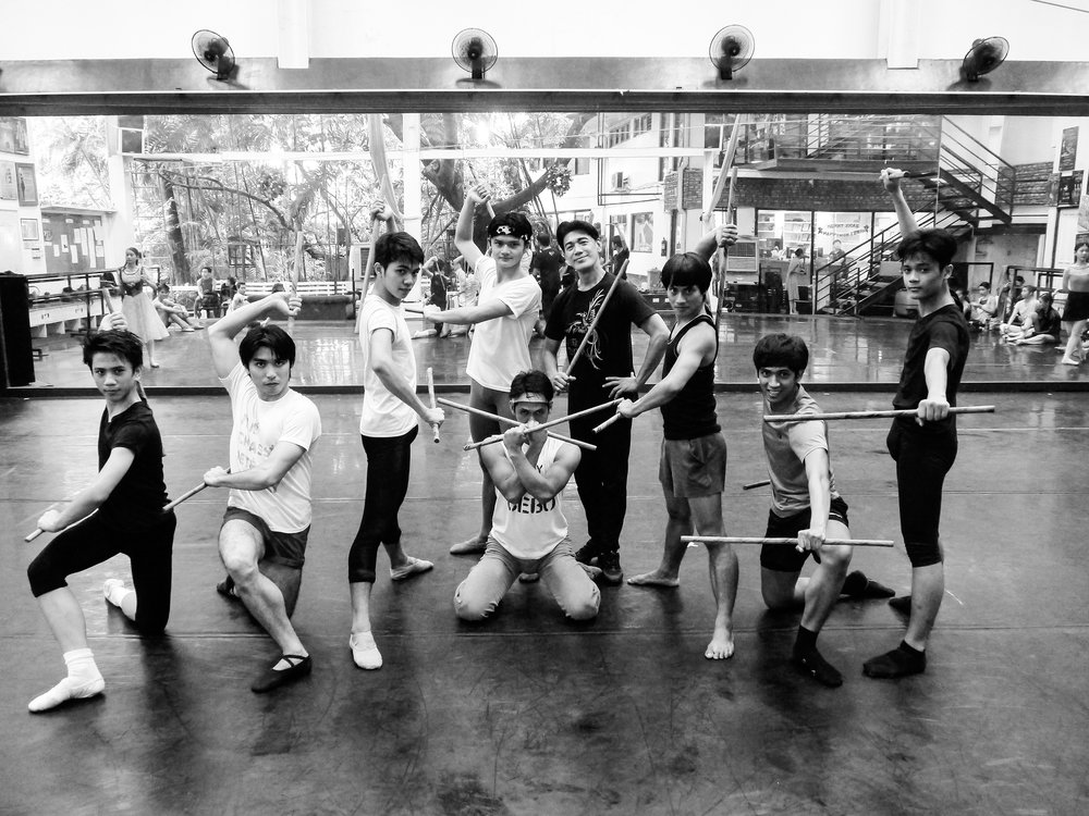 Arnis    dancers through the generations: Shaz Barroso (fifth from left, standing) was part of the group that premiered the piece in 1998; Romeo Peralta (second from left) and Alvin Santos (third from right) belong to the older batch who learned it in their teens. Photo by Giselle P. Kasilag