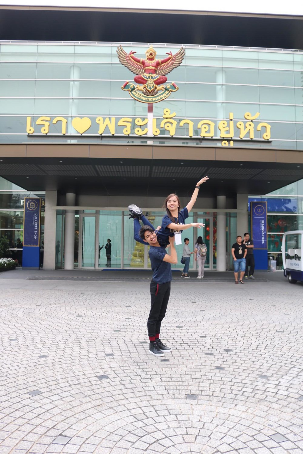 Alvin Dictado and Elyssabeth Apilado demonstrate a shoulder lift outside the AKSRA Theater, the competition venue, on registration day.