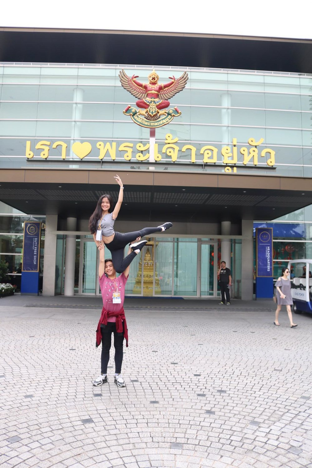 Brian Sevilla and Shaira Comeros practice an overhead lift in front of AKSRA Theater.