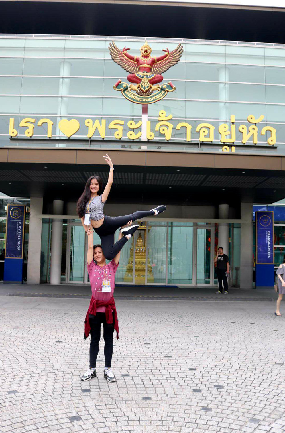 Uplifted: Brian gives partner Shaira a boost in front of the theater where they competed in Bangkok.