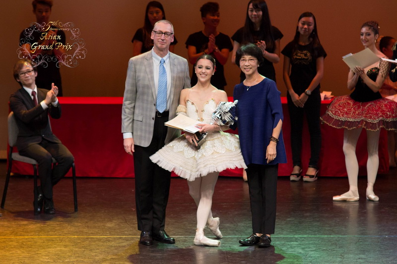 Ballet Manila principal dancer Katherine Barkman won the top prize at the 2015 Asian Grand Prix, receiving her trophy from jury president Garry Trinder and jury member Zhao Yu Heng. Photo courtesy of Asian Grand Prix