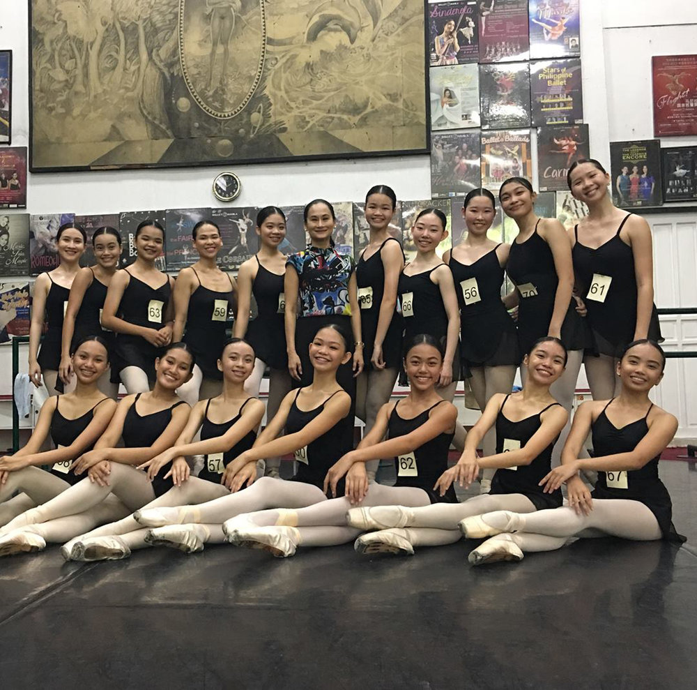 The Lisa Macuja School of Ballet Manila director Lisa Macuja-Elizalde (standing, center) poses with the Level 3 girls in Donada, Pasay. They were among the students who took the school's ballet exams being administered for the first time.