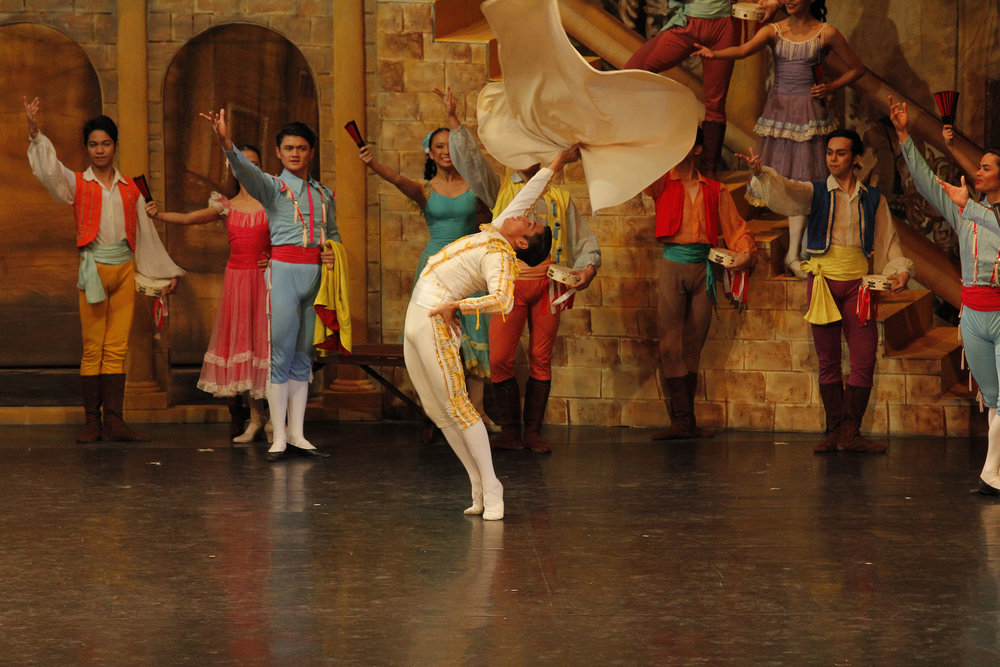 Taking on a supporting role in    Don Quixote   , Joshua (second from left) dreams of dancing in the ballet's full-length version as Basilio (performed here by Mark Sumaylo). Photo by Ocs Alvarez