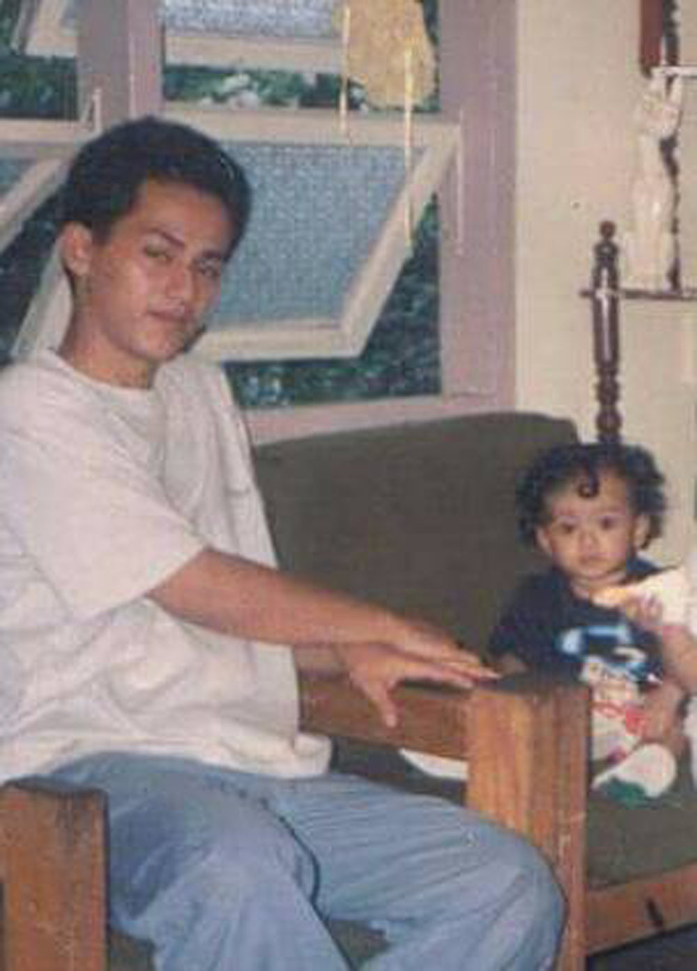 Sean as a toddler with his father who taught him things by example.