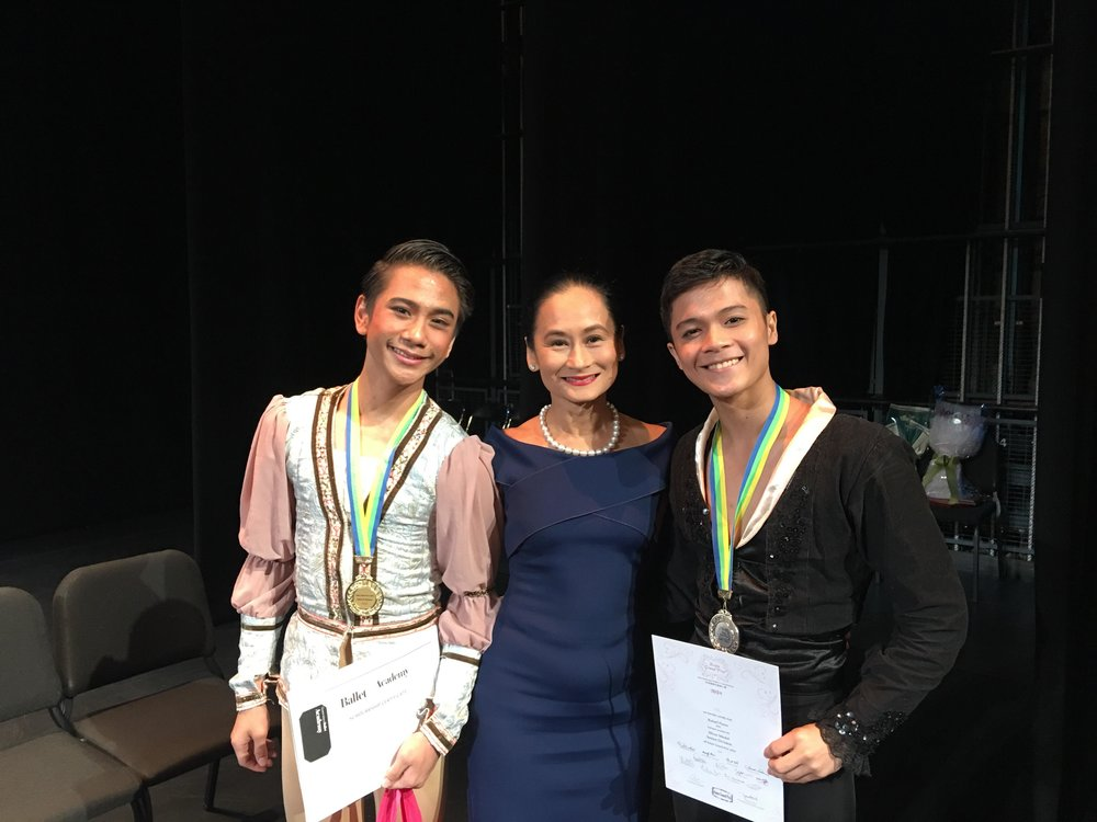 Asian Grand Prix gold medalist Brian Sevilla (left) and silver medalist Rafael Perez celebrate with Lisa Macuja-Elizalde, Ballet Manila artistic director and BM School director, after awarding ceremonies at the Hong Kong Academy for Performing Arts.