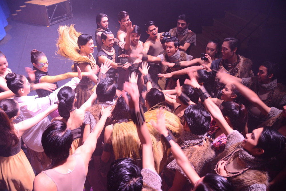 Ballet Manila co-artistic director Osias Barroso (upper left, wearing collar) gives a pep talk to the BM delegation shortly before going on stage to perform in  Ibong Adarna  as part of the Karmiel Dance Festival. Photo by Mark Sumaylo