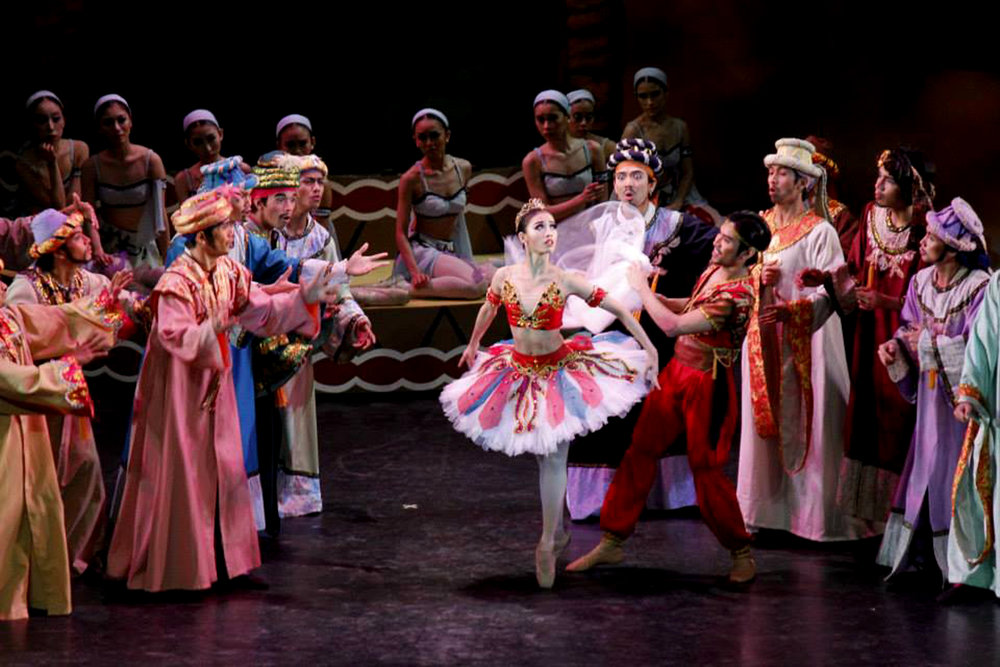 "Joan Emery Sia, now a principal dancer, is featured here in the ""reveal"" scene with fellow principal dancer Romeo Peralta as Lankadem. She was among the four Gulnaras in the 2013 restaging of  Le Corsaire.  Photo by Jimmy Villanueva"