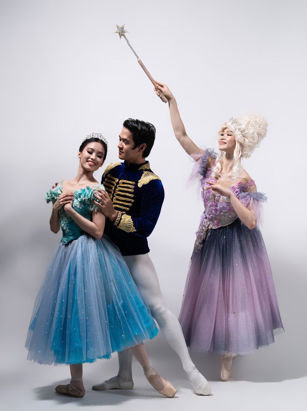 Ballet Manila principals Joan Emery Sia and Rudy De Dios, as Cinderella and Prince Charming, meet and fall in love in a grand ball – with the help of Fairy Godmother (Kong Ke Xin). Photo by MarBi Photography