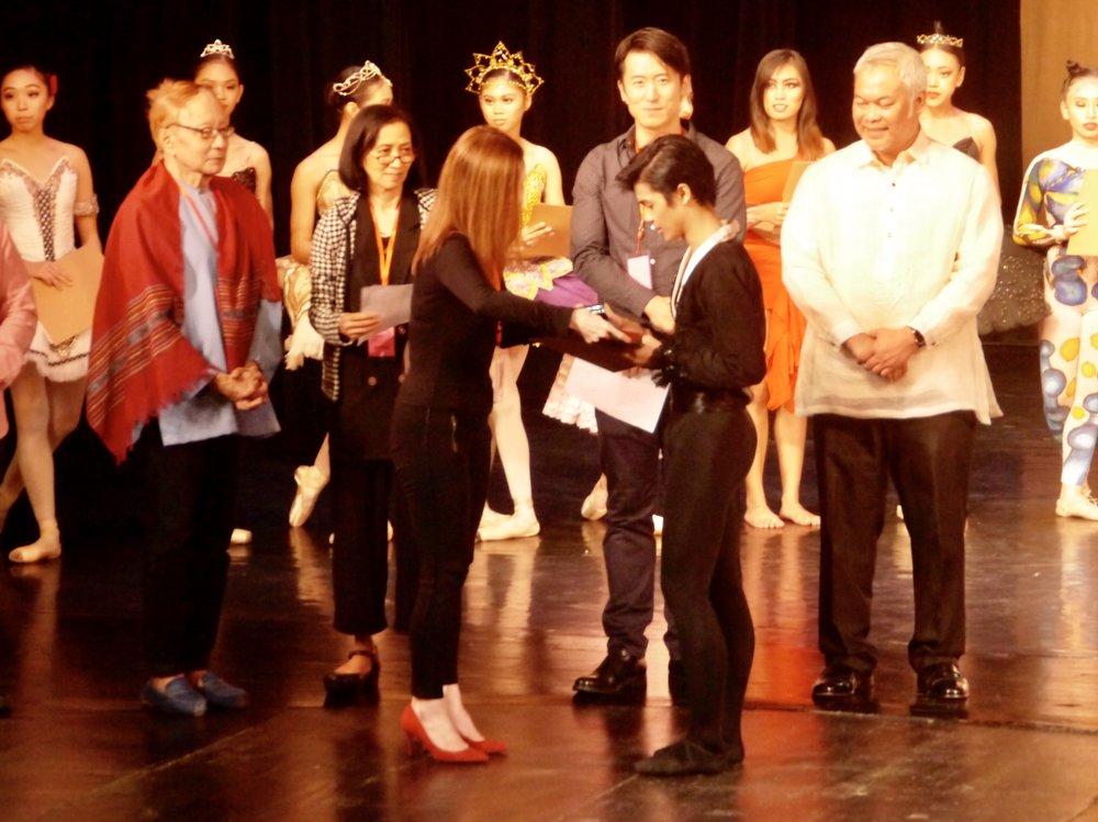 Second prize winner Rafael Perez receives his award from juror Melanie Motus.