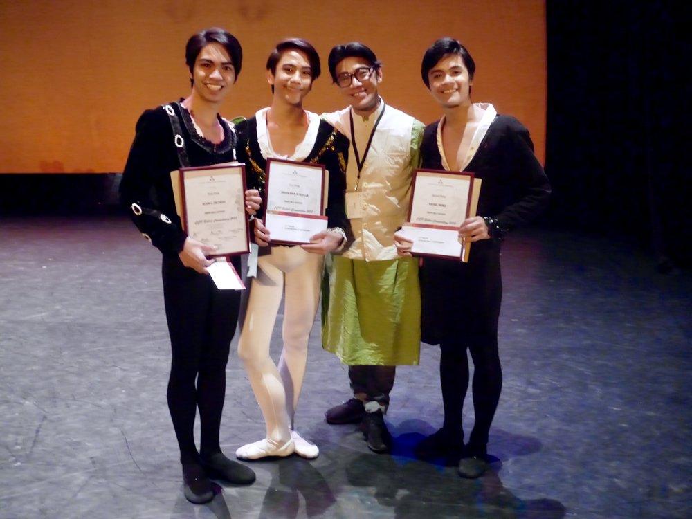 Ballet Manila co-artistic director Osias Barroso congratulates the top three junior male winners in the CCP Ballet Competition: (from left) Alvin Dictado, third prize; Brian Sevilla, first prize; and Rafael Perez, second prize.