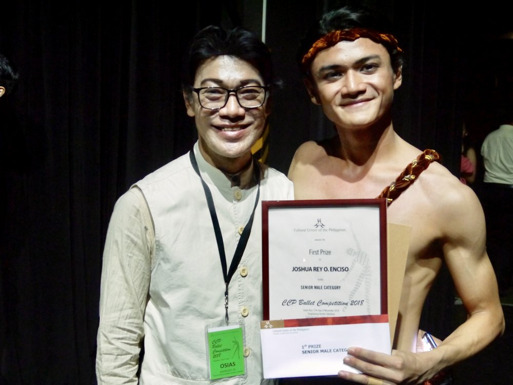 Ballet Manila co-artistic director Osias Barroso joins Joshua Enciso backstage, shortly after the latter was awarded first prize in the CCP Ballet Competition's senior male category.