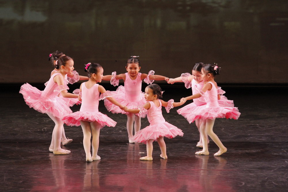 These budding ballerinas dance their hearts out onstage after learning their ballet basics in the Summer Intensive. Photo by Ocs Alvarez