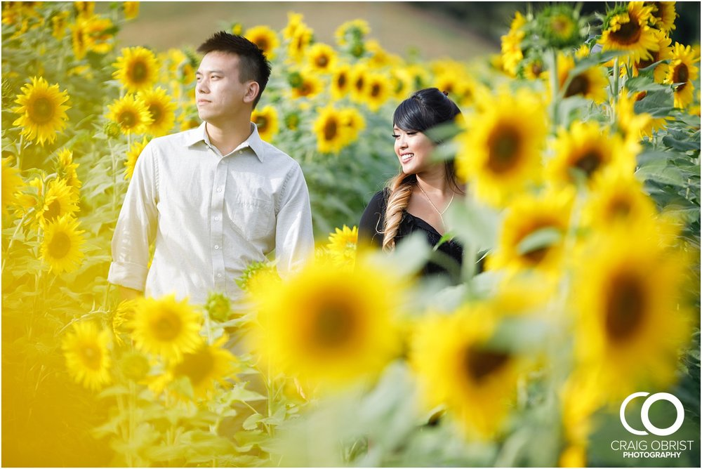 Sunflower field engagement portraits sunset mountains georgia_0011.jpg