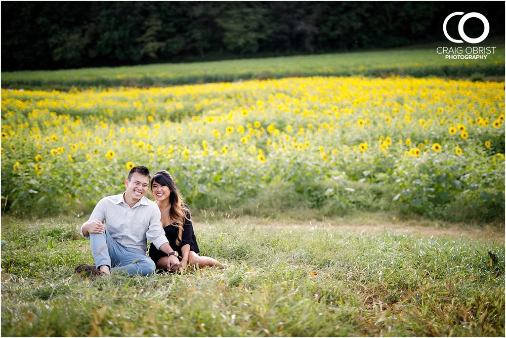 Sunflower field engagement portraits sunset mountains georgia_0018.jpg