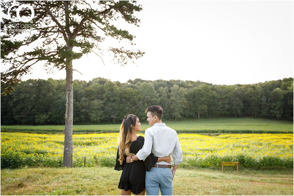 Sunflower field engagement portraits sunset mountains georgia_0023.jpg
