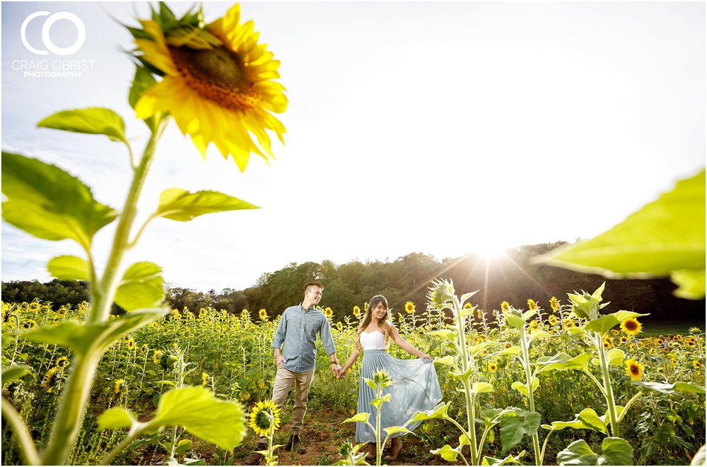 Sunflower field engagement portraits sunset mountains georgia_0024.jpg