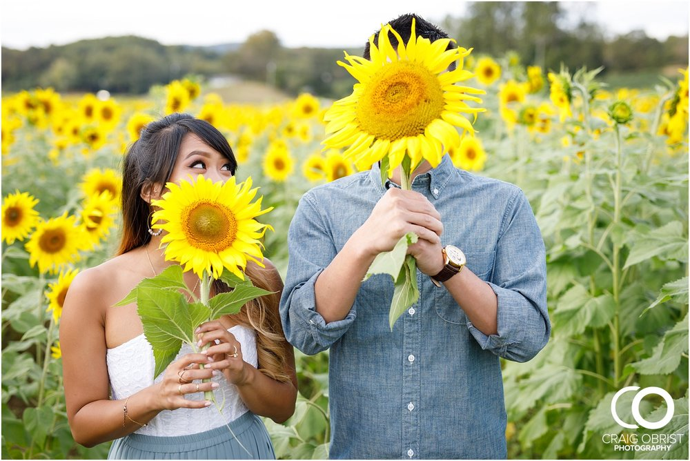 Sunflower field engagement portraits sunset mountains georgia_0034.jpg