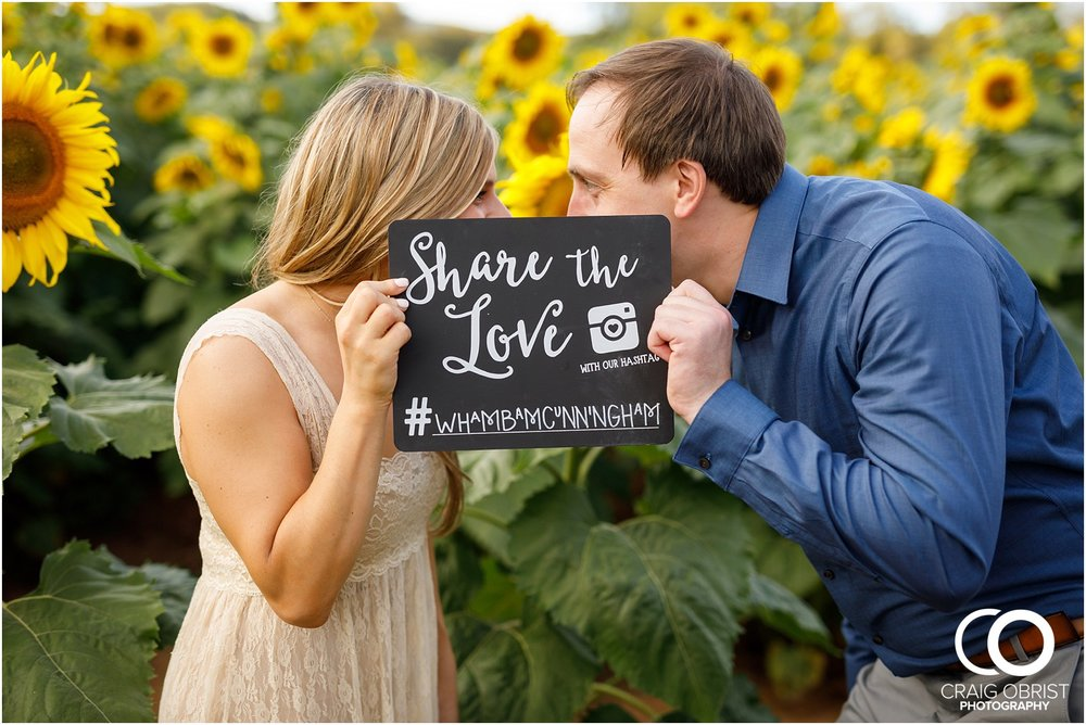 sunflowers fields north georgia engagement portraits wine vineyard_0027.jpg