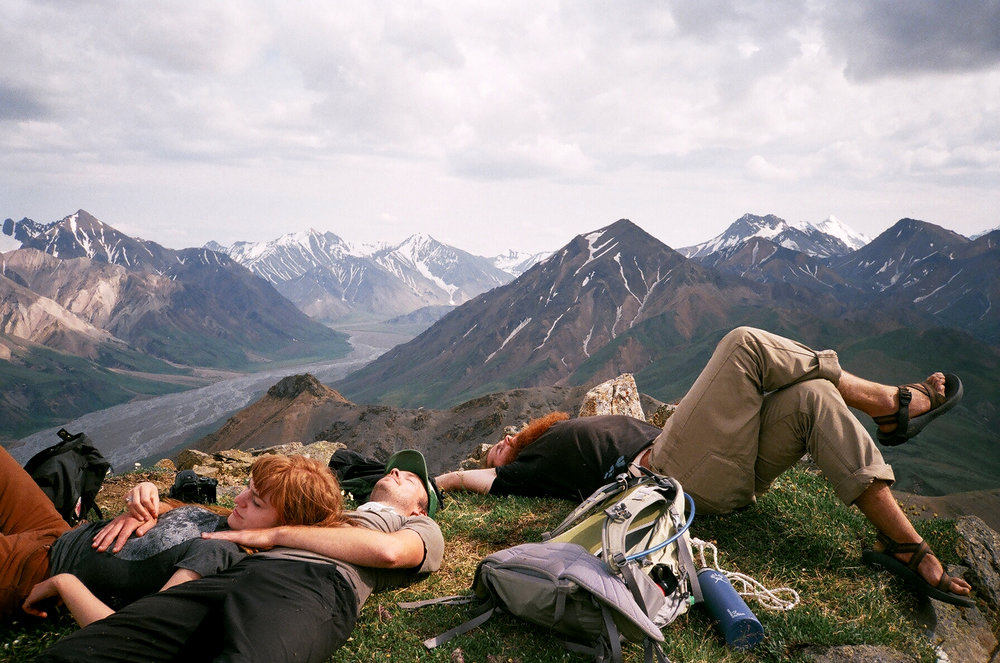 A tundra nap on the summit of Divide Mountain in Denali National Park
