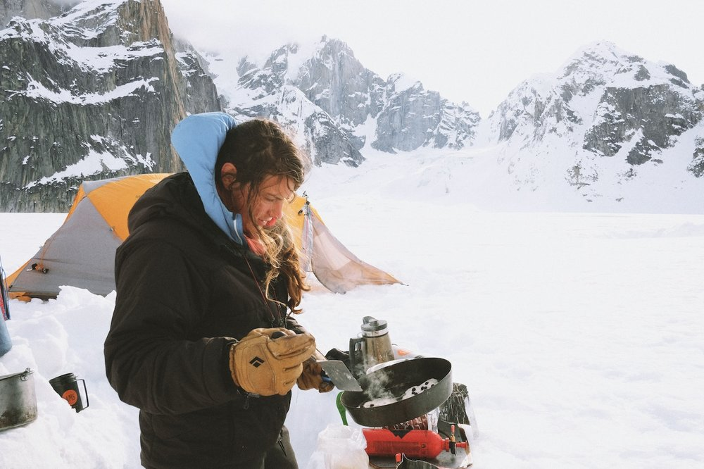 Chelsea cooks early morning pancakes on the Ruth Glacier