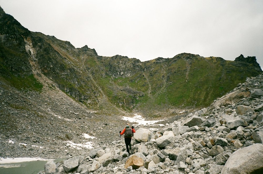 Taylor picking her way through boulder fields in the Talkeetna Mountains.