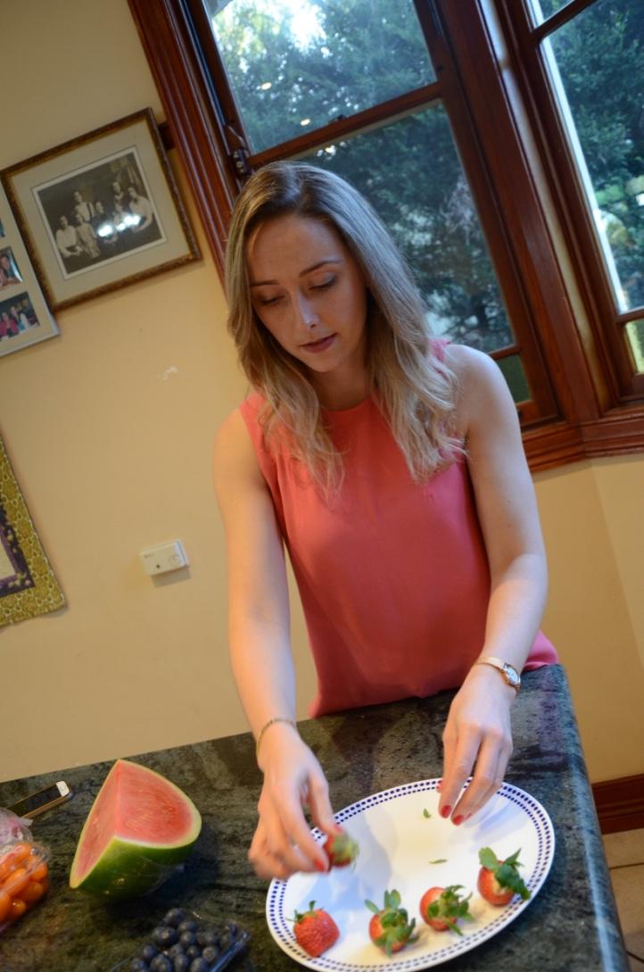 Making a seasonal fruit platter.