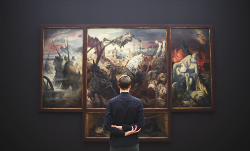 man looking at a paintng in museum.jpg