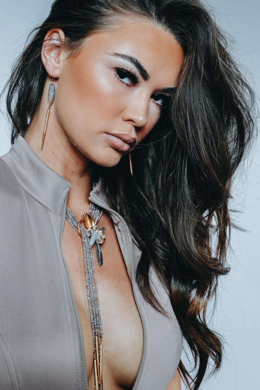 model wearing long dangle earrings