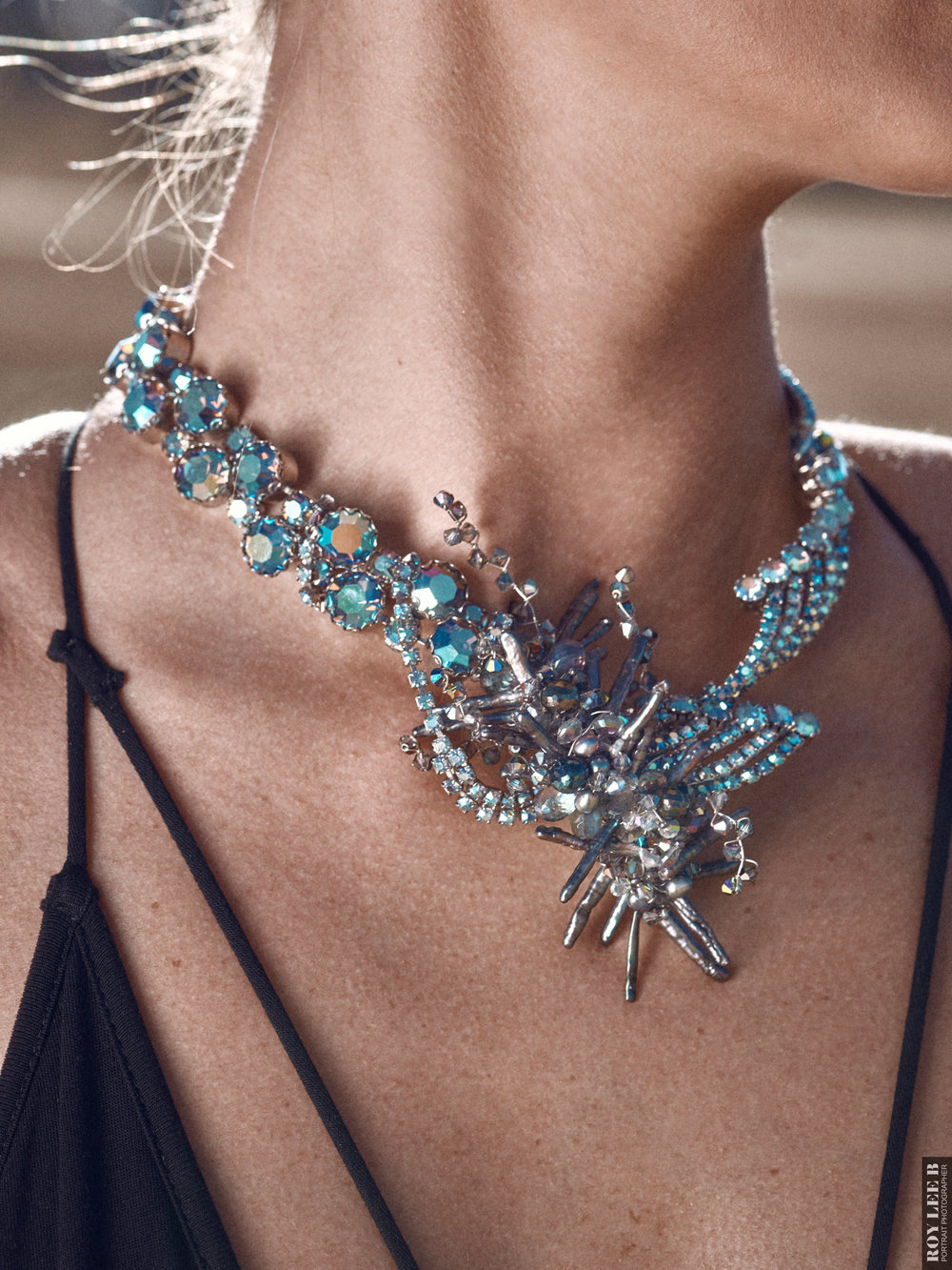 model wearing statement necklace