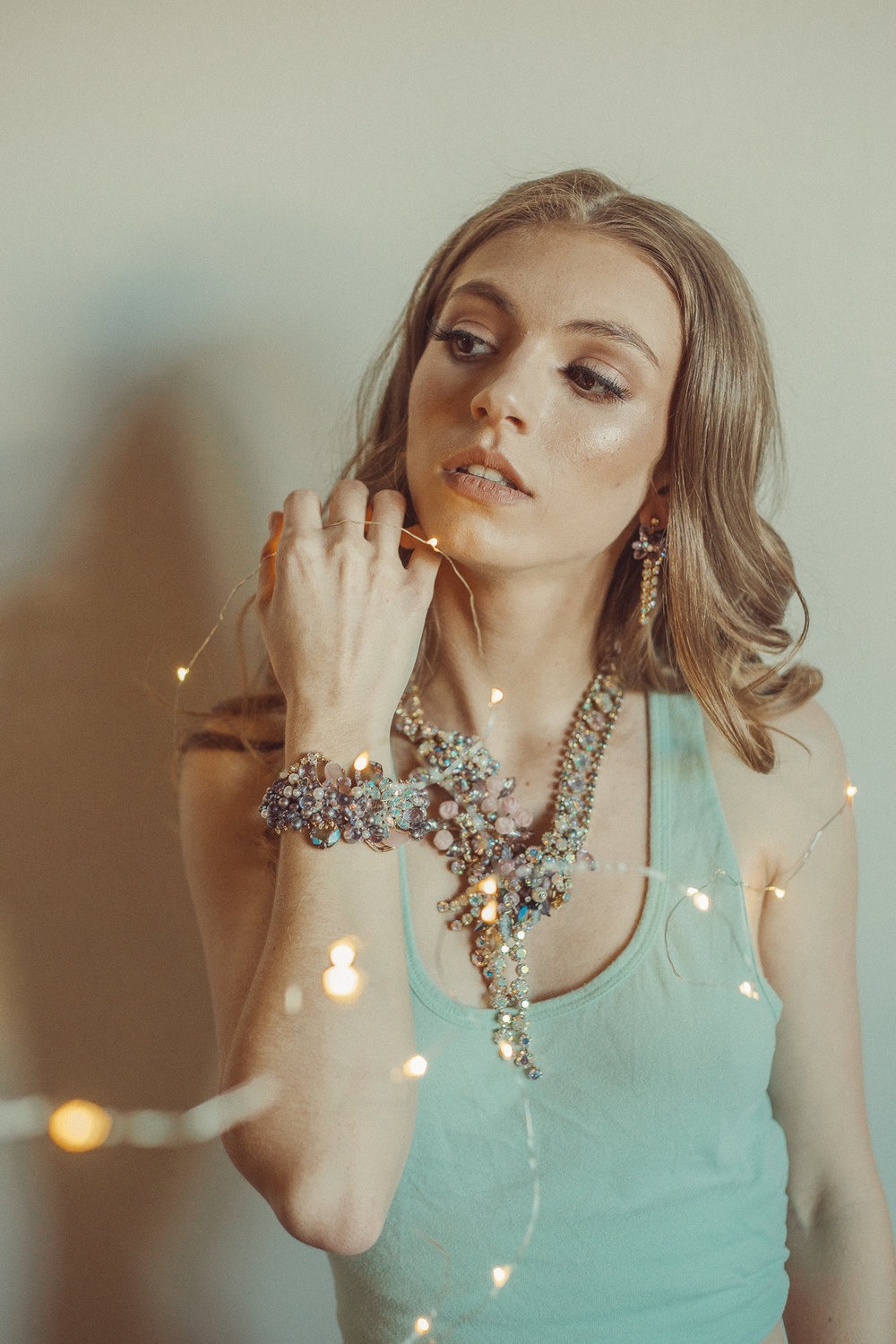 Model wearing statement necklace and cuff