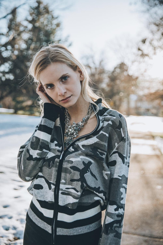 Model wearing statement vintage necklace