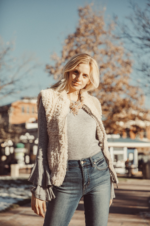Model wearing statement vintage necklace with sunstones