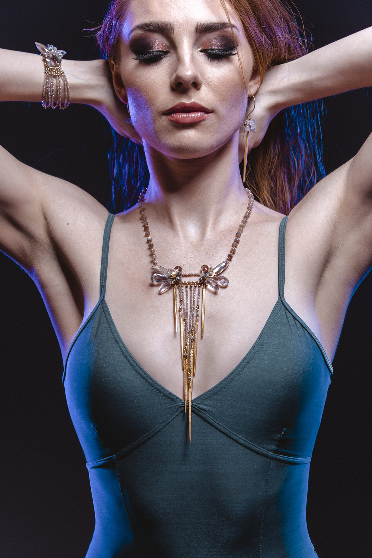 Model wearing long multi drop bib statement gemstone necklace