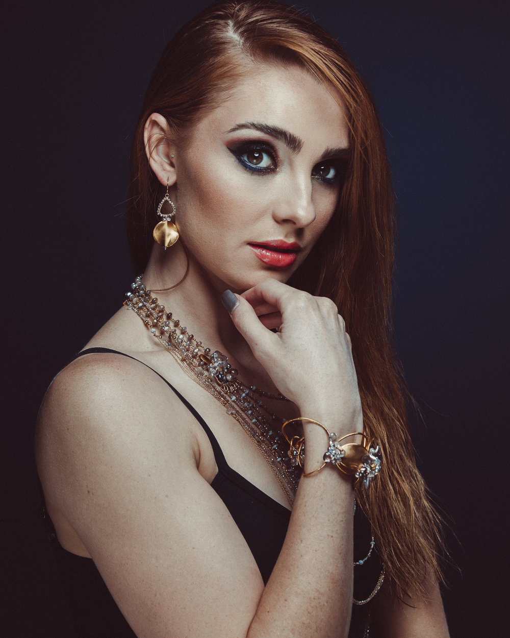 model wearing multi-strand necklace