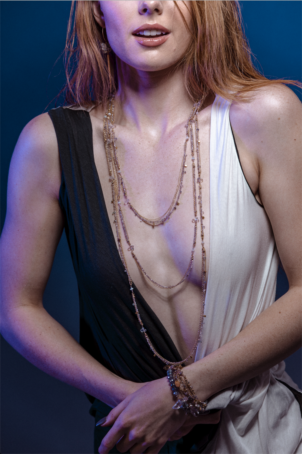 model wearing long layering necklaces
