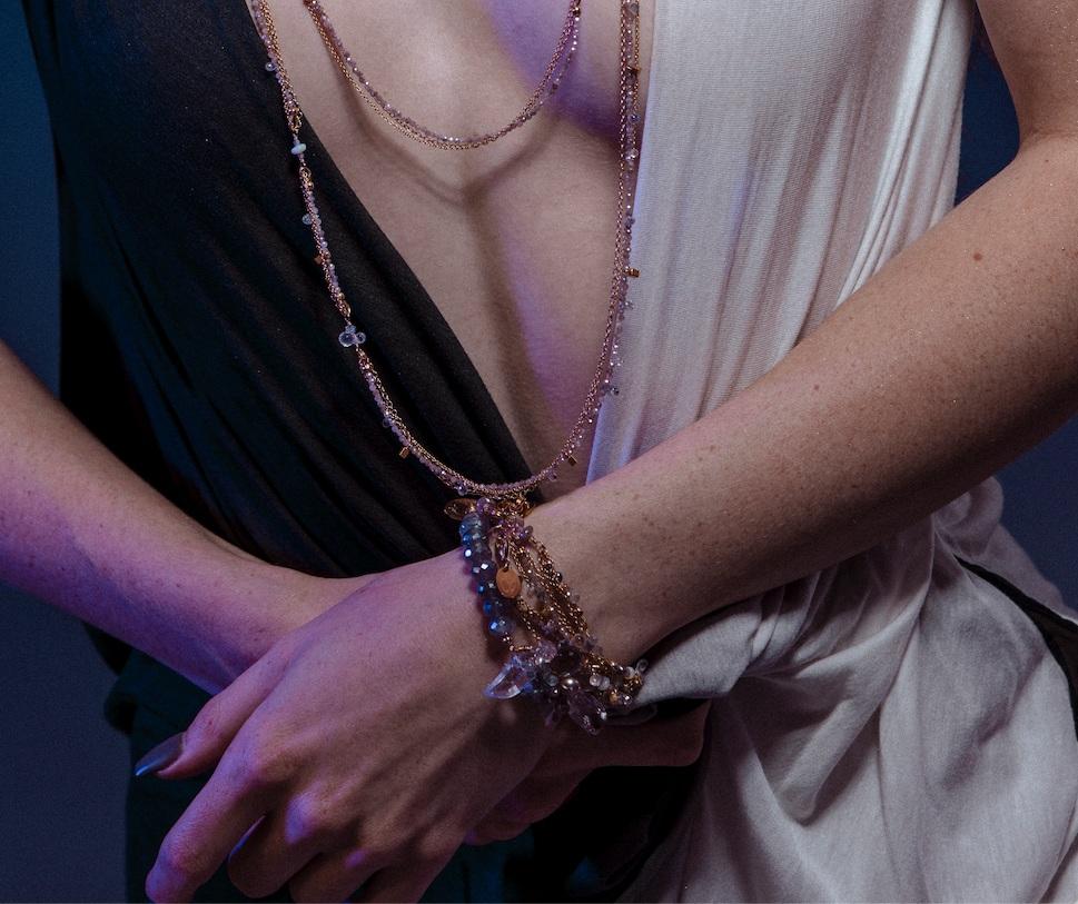 Model wearing layering bracelets